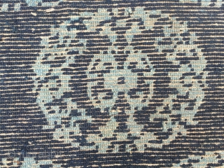 Tibetan rug fragment, blue background with white group flower pattern.  good age and condition. Size 74*57cm