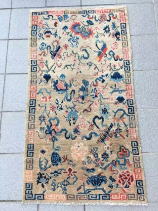 "Tibet rug, light camel background with Buddha eight treasures pattern. Size 153*82cm(60*32""). Good age and condition."