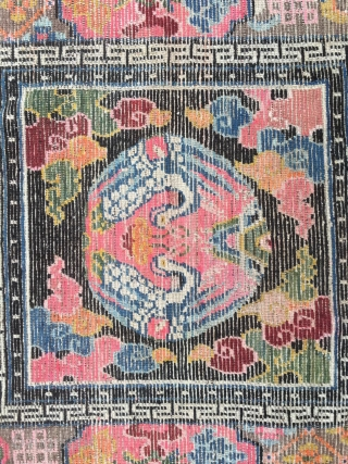 #1779 Tibet rug, black backround with group crane and lucky cloud, eight treasures of Buddha selvage. good age and quality. size 90*90cm(35*35'')