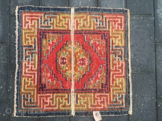 #1880 Tibet saddle rug,rare square horse saddle, red background with group flower patten, colorful Hui veins selvage, symbolize longevity, rich and good fortune. good age and quality. size 60*55cm(23*21'')