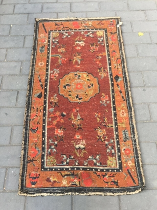 #1903 Tibet rug, red background wiht single group flower and around full of flower pattern.