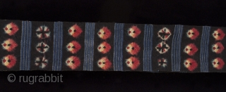 """Kaabo nambu belt or sash, Tibet. These sashes are tied over a coat. Nagbu-tigma (tie-dye) on black wool. 6.5"""" (16.5 cm) wide by 152"""" (386 cm)."""