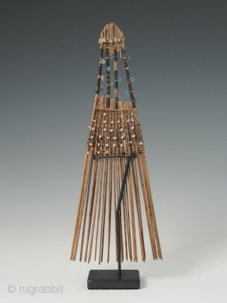 "Comb (helu), Tonga. Coconut palm leaf, plant fibre, fine wire, seed beads. Mid-20th century. 7.5"" (19 cm) high. Combs like this were indicative of rank and worn in the hair as ornamentation,  ..."