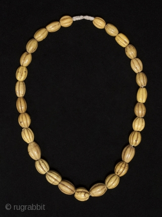 """Yellow melon beads, China or Venice. Wound glass, Late 19th century, 26"""" (66 cm) long as strung, 29 beads.  These beads are found in Irian Jaya and used as bride price. From Robert Liu's book Collectable Beads,  ..."""