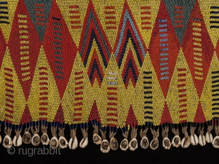 """Pikuran (cache-sex), Bana Guili people, Mandara Mountains, Cameroon. Seed beads, cotton string, cowrie shells, 21"""" (53.3 cm) wide by 9"""" (22.8 cm) high Mid 20th century. These colorful cache-sex were worn for  ..."""