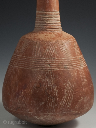 "Terracotta Bottle, Djenne area, Mali, 15"" (38 cm) high by 24.75"" (63 cm) in circumference, late 19th to early-20th century. A handsome terracotta bottle from the Djenne area of Mali with incised  ..."