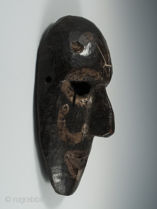 Mask, Middle Hills, Nepal. Wood, 9″ (22.8 cm) high by 6″ (15.2 cm). Early 20th century. A Middle Hills mask with several unusual markings: a trisula carved into the forehead, white painted  ...
