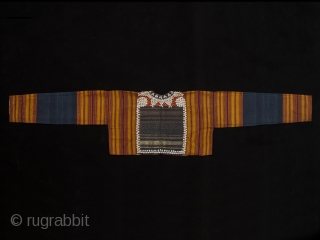 "Young woman's ceremonial jacket, Kauer people, Western Highlands, South Sumatra. 55"" (139.7 cm) wide by 11.5"" (29.3 cm) high. Cotton, nassa shells, mica chips with supplementary weft back panel. Early 20th century.  ..."