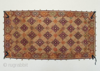 "Cloth, Swat Valley, Pakistan. Cotton, silk, 16.5"" (42 cm) high by 31.5"" (80 cm) wide. Early 20th century. This finely hand-embroidered cloth, possibly a cover for food, shows some thread loss, especially  ..."