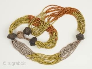"Glass bead necklace, Khond people, Orissa, India. Glass trade beads, brass, cotton string, 33"" (63.8 cm) long. Mid-20th century."