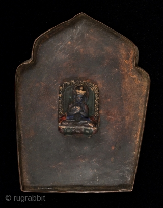 Gau prayer box, Tibet, with a small ceramic figure on the inside of the back panel. It can be seen through the glass window. These were worn while traveling or kept in  ...