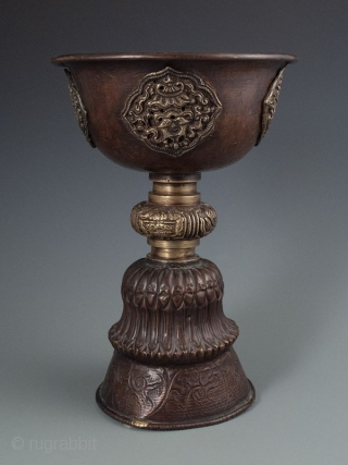 Himalayan Antique Copper Tall Yak Butter Lamp   Antique Himalayan tall yak butter lamp. Made of hand hammered copper with gilt bronze applied details depicting Buddhist auspicious symbols. The butter would have melted and  ...