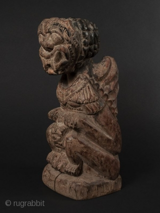Indonesian Wood Guardian Deity  Indonesian wood guardian deity with a fierce crouched posture, bulging eyes, tusks, and wings. The image powerfully carved with probable shamanistic use.   Provenance Private San Francisco Collection   Dates 18th/19th  ...
