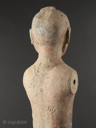 Terracotta Han Dynasty Soldier  Terracotta soldier, nude standing upright without arms, with insertion holes at sides. Red pigment on back of head and lower leg, black pigment at back of head. Remnants of  ...
