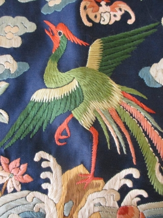 Chinese Rank Badge with Egret  A Chinese rank badge with an egret set in the middle of the square standing on a rocky island surrounded with flowing water and auspicious motifs of peonies,  ...
