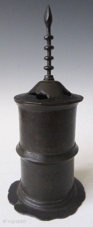 Antique Japanese Bronze Sutra Container  Antique Japanese bronze sutra container of a pagoda form with very tall finial and calligraphy inscription. The bronze shows beautiful green patina inside and on the foot and  ...