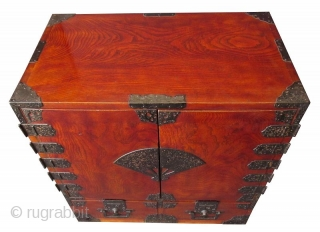 Rare Antique Japanese Solid Keyaki Burl Fan Lock Tansu  A rare and unusual Japanese Keyaki burl choba tansu with original dark red translucent lacquer finish. The front of the chest has two hinged  ...