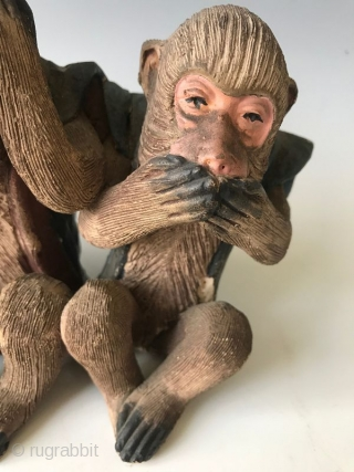 Japanese Terracotta Three Wise Monkeys  A terracotta figure of the Three Wise Monkeys - Mizaru who is covering his eyes, Kikazaru who is covering his ears and Iwazaru who is covering his mouth.  ...