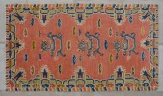 """No.CL043 * Tibetan ? Antique """"Dragon Face"""" Rug.Age: 20th Century.Size: 94x162cm ( 3'1"""" x 5'4"""" ).Origin: Tibetan Shape: Rectangle  Background Color: Oranges"""