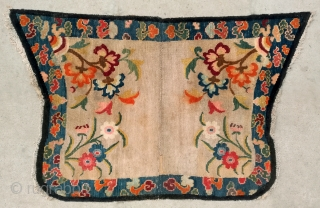 "No.DX089 * Chinese Tibetan Lady Saddle Rugs.Age: Early-20th Century.Size: 70 x 110cm (2'3""x3'7"").Origin: Tibet. Shape: Papilionaceous.Background Color: Off-whites,lvory. Flower design with stylized floating cloud motifs."