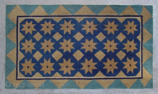 "No.DX003 * Chinese Antique Rug .Origin: Beijing .Age: About 100 Years Old.Size: 83x143cm(2'9""x4'8"").Background Color: Blues and Greens.Shape: Rectangle .This simple and elegant carpet has a field of stars and diamonds. The outer  ..."