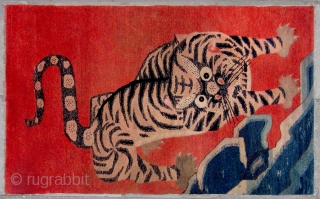 """No.CL060 * Chinese Antique """"Tiger """" Rug.Age: Late 19th Century.Size: 100x162cm ( 3'3"""" x 5'4"""" ).Origin: Baotou-Suiyuan. Shape: Rectangle.Background Color: Reds. A heroic bearing tiger is setting off. This rug was probably  ..."""
