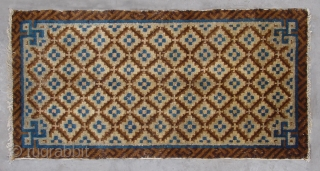 "No.R040 * Chinese Antique Rug .Size: 51x100cm(1'9""x3'3"").Origin: Baotou. Age: Early-19th Century.Shape: Rectangle.Background Color: Browns .The field is composed of a very nice flower lattice pattern. The rug was woven in classic brown  ..."