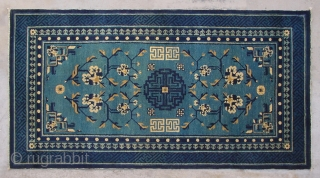 """No.P95 * Chinese Antique Rug ,Origin:Beijing.Age:Late 19th Century. Size:87x161cm(2'10""""x5'3"""").Shape:Rectangle. Background Color: Blues and Greens.  This sleeping carpet (khaden) has a single central medallion in a double dorje (a Tibetan male symbol) pattern. The  ..."""