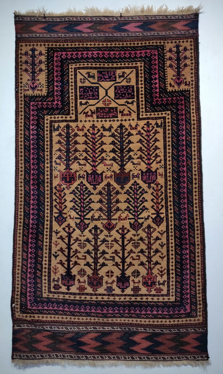Baluch prayer rug with Shia inscriptions reading 'Allah, Muhammad, Ali, Hasan, Hussein,  Gallery Aydin, Hali Fair, London, 2019