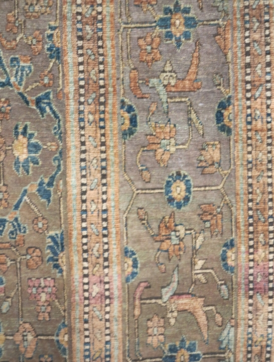A silk and metal-thread Khotan carpet, lot 124