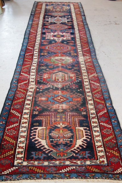 "Just in! 19th century North-west Persian runner. 4.00m x 1.05m  (13' x 3'6""). Really good colours, and strong design. Archaic drawing of the medallions. Note also how each medallion is different!  ..."