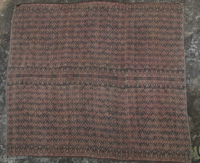Good Flores Island ikat, three paneled all hand wove woman's sarong made with natural dyes and hand spun thread. Circa 1950 +/- W: 1.52cm/60in and L: 160cm/63in. There are two small 2mm  ...