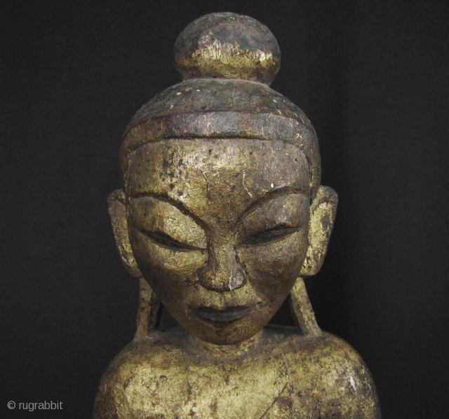 Very rare standing wood folk image of the Buddha statue from the Tai Lue ethnic group in the Golden Triangle region. This Buddha is classically robed in the Mandalay style with a  ...
