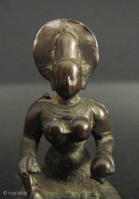 Small bronze image of Annapurna; the Goddess of the hearth and food (as well as a whacking big mountain named after her). She sits holding a ladle with which she feeds the  ...