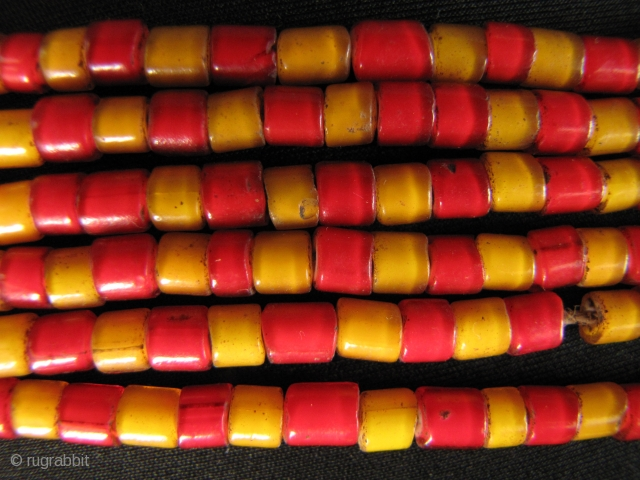 "Venetian Trade Beads: 19th century colonial trade beads from Venice.They are a combination of red and yellow ""white hearts"" $70 each strand: free shipping. These are strung on hemp or some kind  ..."