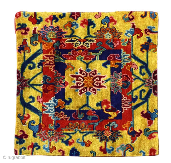 """A pair of khagangma Tibet circa 1900 92 x 90 cm (3' x 2'11"""") asymmetrically Tibetan knotted silk pile on a cotton foundation  A possibly unique pair of silk meditation mats decorated by the so-called brocade square  ..."""