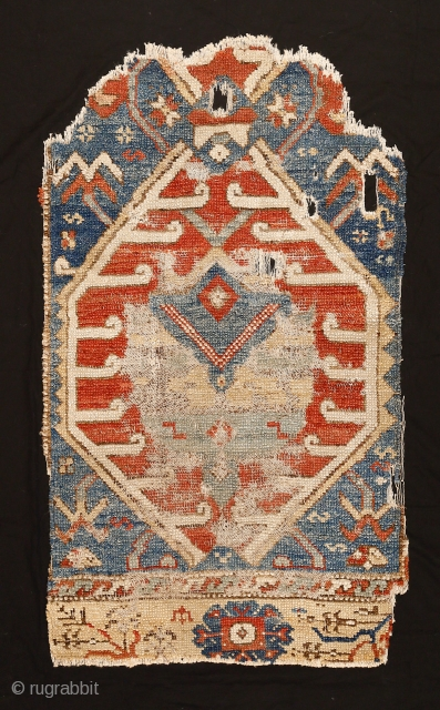 Rare and beautiful fragment of a 17th/18th century Karapinar rug with directional palmettes and stylised tulips, Central Anatolia. An example with this pattern is in the Al-Sabah Collection, Kuwait National Museum and  ...