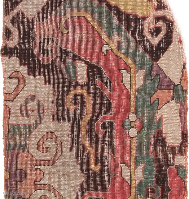 Detail of a stunning early Caucasian pile rug fragment with large sickle leafs.