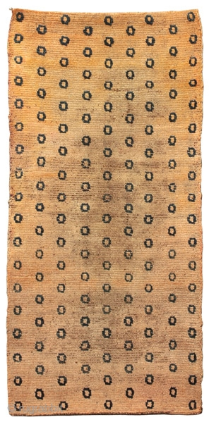 """Rug with leopard pelt pattern Tibet circa 1880 120 x 65 cm (3'11"""" x 2'2"""")  L 96 symmetrical Tibetan knotted wool pile on a wool foundation Recently sourced in Tibet, this unique rug is distinguished by a  ..."""