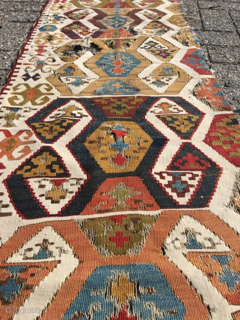 Early Anatolian hooked kilim, one wing. Clean, very good colors (purple, apricot, nice greens), good condition for it's age. Interesting use of dark hooks as partitioning elements, creating a rhythm throughout the  ...