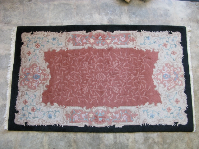 Art Deco Chinese rug, hand knotted wool, China, ca.1920, tan to earthy rose floral with eggshell main border and black outer border, Nichols type, thick pile and heavy, minor dings and stains  ...