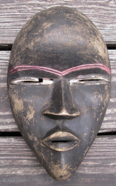 Vintage African mask, Dan People, Liberia, hand carved wood and pigment, wear, dings and chips, especially to raised areas and the rim, mostly seen from the back, the approximate size is 6.5in  ...