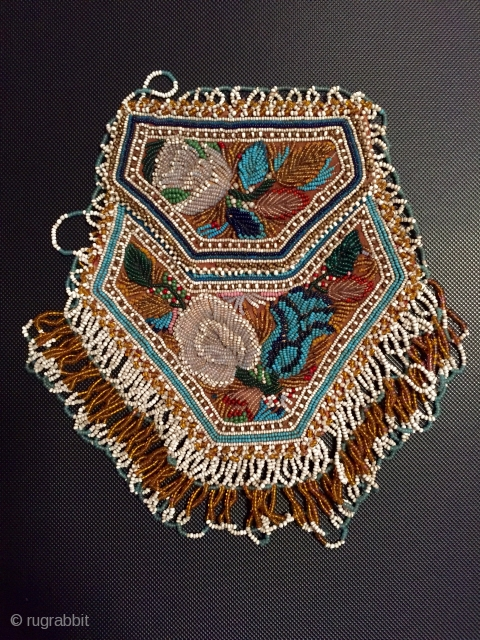 Charming antique American Indian beadwork purse the finest of this type I have seen. Late 19 c in excellent condition including the satin lining with small pocket