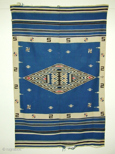 "a weaving from the ""Rio Grande"" tradition, i.e., from central and northern New Mexico that has a lot of mexician Saltillo serape influence ca 1910-1930 size  80"" X 51"".  Made  ..."