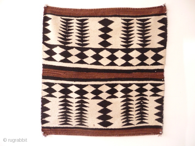 Navajo , very pretty and striking early 20th cent. saddle rug , good condition ,from an English collection, 2ft 5in x 2ft 4in.SOLD
