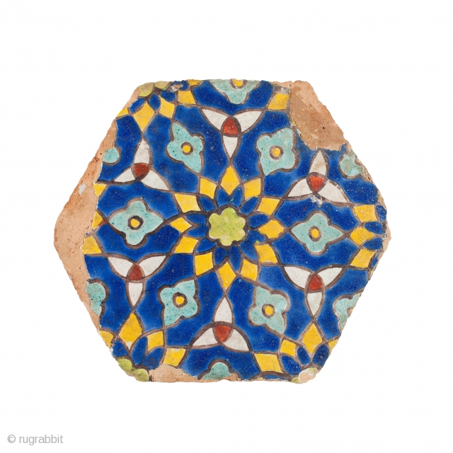 Timurid cuerda seca pottery tile, of hexagonal shape, moulded, decorated with polychrome rosettes and trefoil motifs, Samarkand, early 15th century, diam. 26.5 cm Published: Arts from the Land of Timur. An Exhibition from  ...