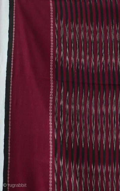 Ikat shoulder cloth, ulos, cotton, Batak, Sumatra, Indonesia   Rectangular handwoven cloth, cotton ,  center field: ikat patterning with arrow head design in white, red and dark blue/black , two side stripes  ...