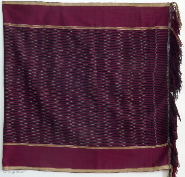 Ikat shoulder cloth, ulos, Batak, Sumatra, Indonesia, ca. 1950  Rectangular handwoven cloth, center field, ikat patterning with arrow head design in white, red and dark blue, wide monochrom red border, multicoloured small stripes,  ...