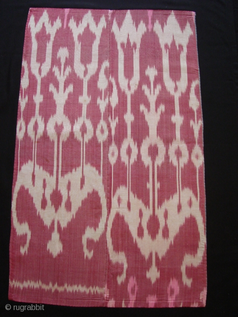 Silk Ikat Fragment. 71cm long and 47 cm wide. On black backing.