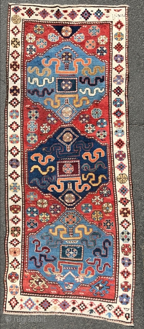 """Lot 411. Auction 30. May 2020.    Shah - Savan tribal rug. Caucasus. Antique, probably 1828. 254 cm x 105 cm. Knotted by hand. Wool on wool. Natural colors. Dated """"1244""""? Cloud band pattern.  ..."""